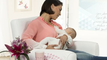 Mum feeding baby with Medela Contact Nipple Shield