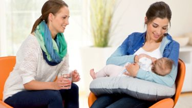Mum breastfeeding baby and Medela PureLan